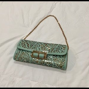 Ivanka Trump mint green with gold purse